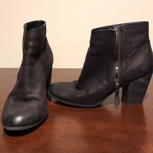 Black zip up heeled booties